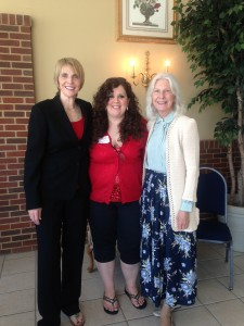 Marti MacGibbon, left, with event planners: Stephanie Burch, center, and Charles County Freedom Landing's Director Joyce Abramson.