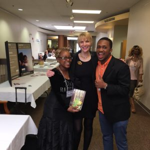 Marti MacGibbon signs copies of Never Give in to Fear for two amazing addiction treatment professionals.