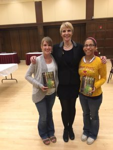 Marti MacGibbon, at ISU/YSS book signing with audience members.