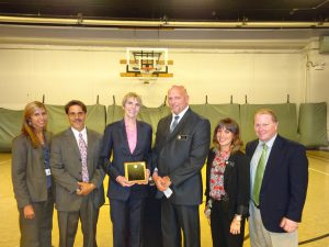 Staff and Assistant Warden of MCC Chicago with Marti MacGibbon. Inmates presented Marti with a plaque in appreciation.